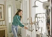 Woman In Faucets And Plumbing Store