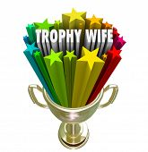 Trophy Wife 3d words in a golden trophy to illustrate the marriage of a young attractive woman to an older wealthy man or husband