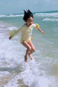 jumping in beach