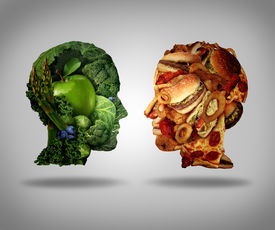 image of headings  - Lifestyle choice and dilemma concept as a two human faces one made of fresh green vegetables and fruit and the other head shaped with greasy fast food as hamburgers and fried foods as a symbol of nutrition facts and healthy living issues - JPG