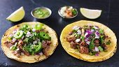 stock photo of tacos  - two authentic mexican tacos with barbacoa and carnitas - JPG