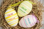 foto of pasqua  - feliz pasqua against close up on three easter eggs - JPG