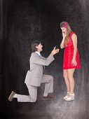 picture of propose  - Hipster on bended knee doing a marriage proposal to his girlfriend against black background - JPG