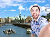 pic of copenhagen  - Happy young man taking a selfie photo in Copenhagen - JPG