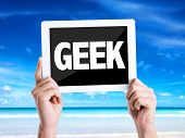 stock photo of dork  - Tablet pc with text Geek with beach background - JPG