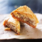 image of baklava  - two baklava halves sitting on wax paper - JPG