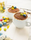 pic of easter candy  - Easter cream dessert tiramisu based in portioned cups are decorated sweet candy in the form of eggs - JPG