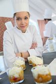 foto of confectioners  - Closeup of smiling young pastry confectioner - JPG