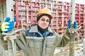 picture of millwright  - construction site worker at concrete works at building area  - JPG
