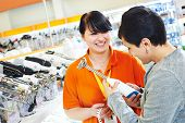 picture of blender  - Young woman choosing electric blender in home appliance shopping mall supermarket - JPG