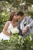 image of intimate  - Newly married couple having intimate moment together in garden - JPG