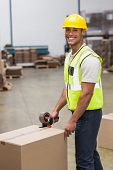 picture of dispatch  - Worker in warehouse preparing goods for dispatch - JPG