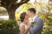 pic of intimate  - Newly married couple in intimate embrace in garden - JPG