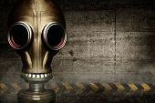 foto of rubber mask  - Gas mask shrouded in smoke on wall background - JPG