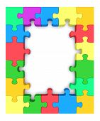stock photo of jigsaw  - Beautiful frame made up of pieces of colored jigsaw puzzle - JPG