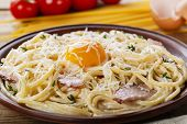 foto of carbonara  - pasta carbonara on a plate with egg yolk and parmesan cheese - JPG