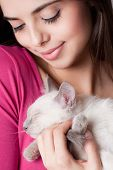 picture of siamese  - Gorgeous young brunette holding sweet young siamese kitten - JPG