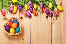 picture of gift basket  - Spring Flowers bunch and easter eggs at wood floor texture - JPG