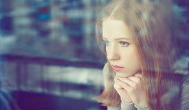 image of sad  - alone thoughtful sadness girl is sad at the window - JPG