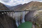 picture of dam  - dam with overflow with high jump of water - JPG