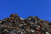 pic of scrap-iron  - Scrap metal yard with clear blue sky - JPG