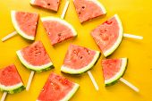 stock photo of watermelon slices  - Yummy watermelon slice popsicles for refreshing treat - JPG