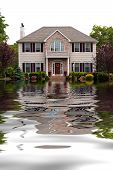 stock photo of flood  - House with flood damage concept with water reflections - JPG