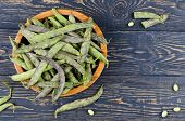 foto of soybeans  - Green fresh soybeans on wood background - JPG