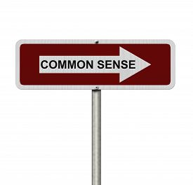stock photo of senses  - The way to Common Sense Red and white street sign with word Common Sense isolated on white - JPG