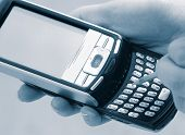 Texting with a PDA phone Close Up