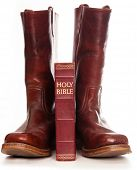 Boots and the bible against white background