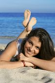 picture of beautiful brunette woman  - Beautiful young woman resting on the beach - JPG