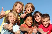 stock photo of mixed race  - happy kids with thumbs up - JPG