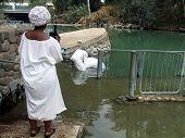 People Baptizing In Jordan River/Holy Land/Israel