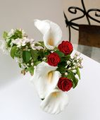 Bouquet with a rose and calla on a white background