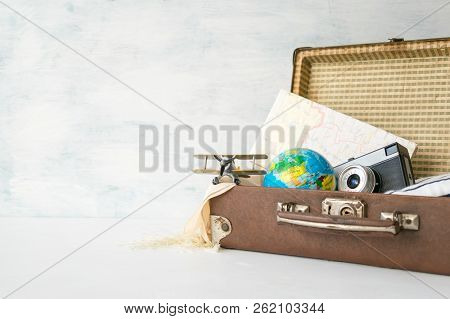 poster of Travel, Adventure, Vacation Concept. Brown Retro Suitcase With Traveler Set Of Travel Booklets, Maps