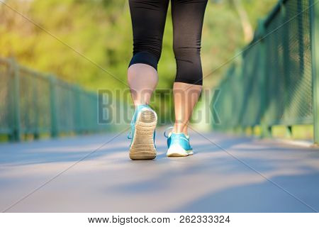 Young Athlete Woman Running In