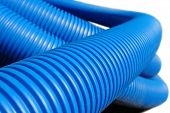 Coil of blue plastic corrugated plumbing pipe over white