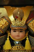 Japanese Traditional Doll wearing a hat known as Kabuto