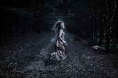 Scared Girl Running Through Forest poster