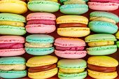Sweet Almond Colorful Pink, Biue, Yellow, Green Macaron Or Macaroon Dessert Cake Background. French  poster