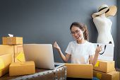 Young Women Happy After New Order From Customer, Business Owner Working At Home Office Packaging On  poster