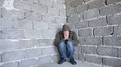 Desperate Unhappy Man By The Wall. The Concept Of Stress And Hopeless poster