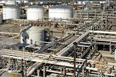Oil refinery for making gasoline, diesel, and other fuels along with pollution and harm to the envir