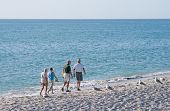 Senior couples walking on the beach of captiva island in florida