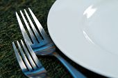 Modern silverware arranged in a place setting on a table