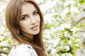 Beautiful Spring Brunette Girl with flowers