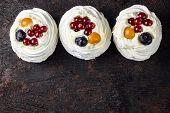 Delicious Mini Pavlova Meringue Cake With Berries poster
