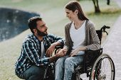 Girl On Wheelchairs With Boyfriend In Summer Park. Disabled Young Woman. Woman On Wheelchair. Relaxi poster