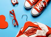 Glasses, Heart Shaped Toy, Clock, Gumshoes, Jacket On The Hanger And Laptop On The Blue Background poster